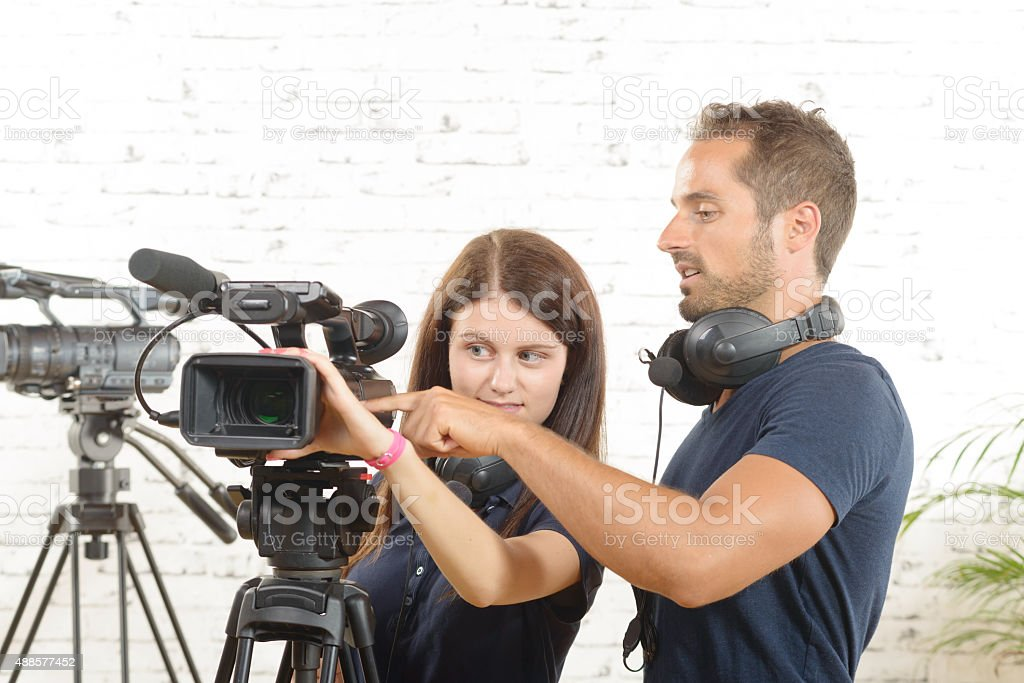 cameraman and a young woman with a movie camera stock photo