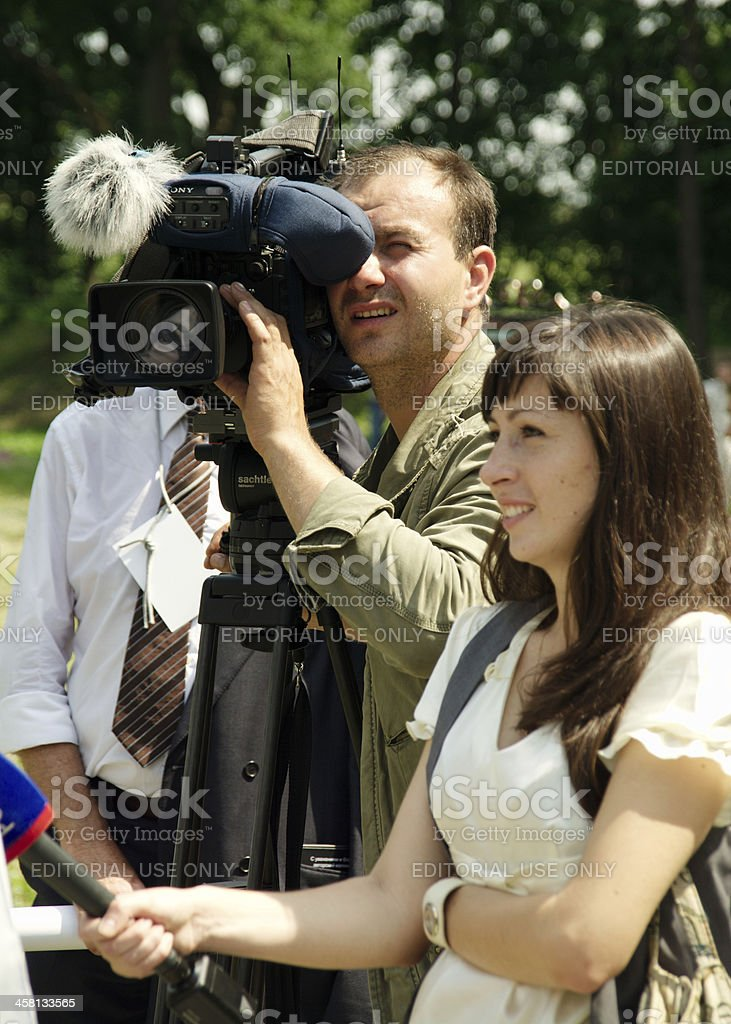 cameraman and correspondent royalty-free stock photo