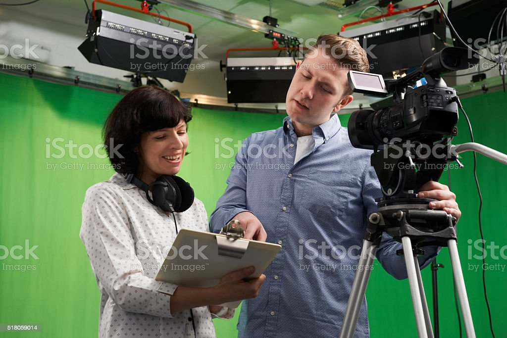 Cameraman And Floor Manager In Television Studio stock photo