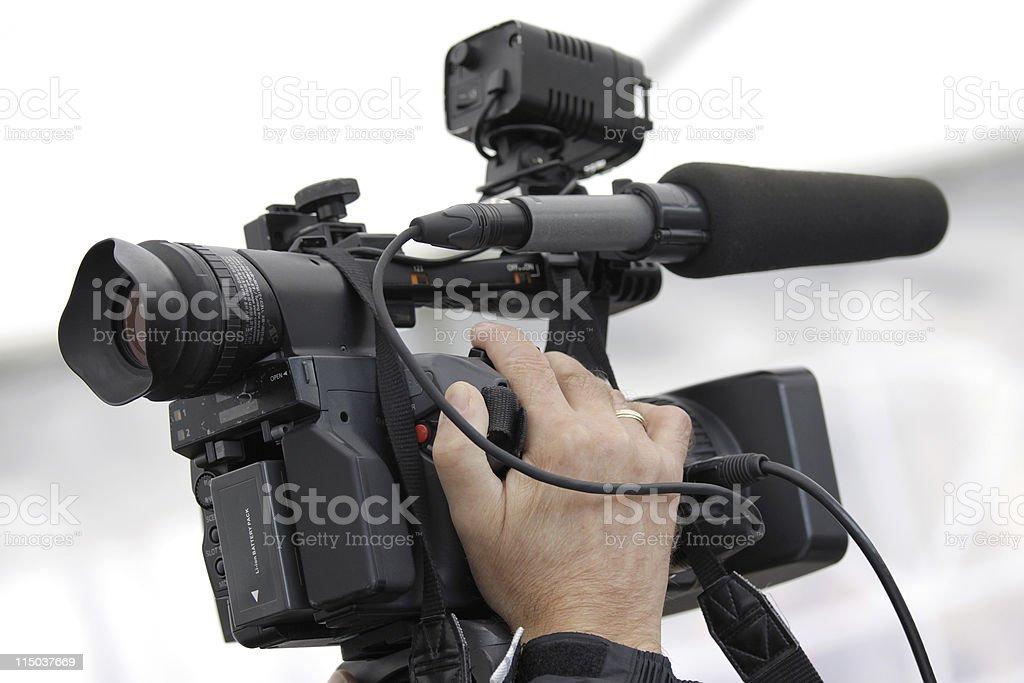Cameraman and video camera royalty-free stock photo
