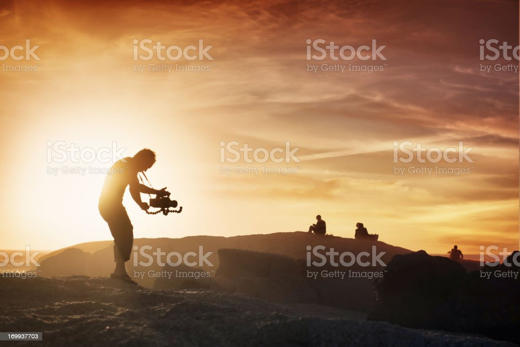 Cameraman at sunset stock photo