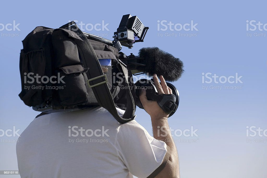 Cameraman at work outdoors stock photo