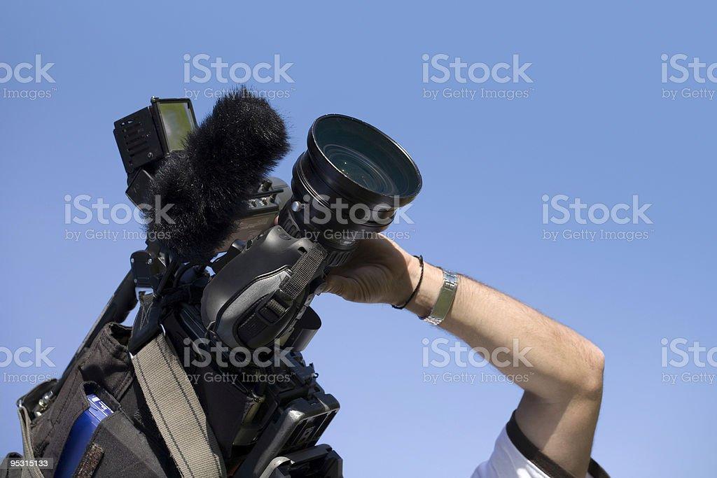 Cameraman at work royalty-free stock photo
