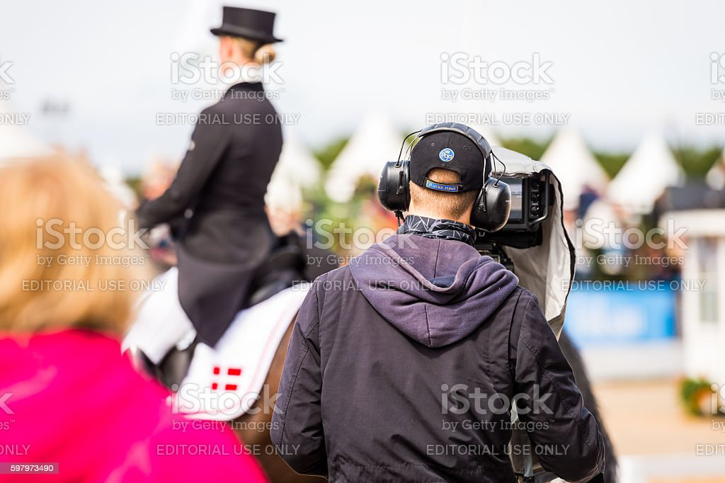 TV cameraman filming dressage at Falsterbo horse show stock photo