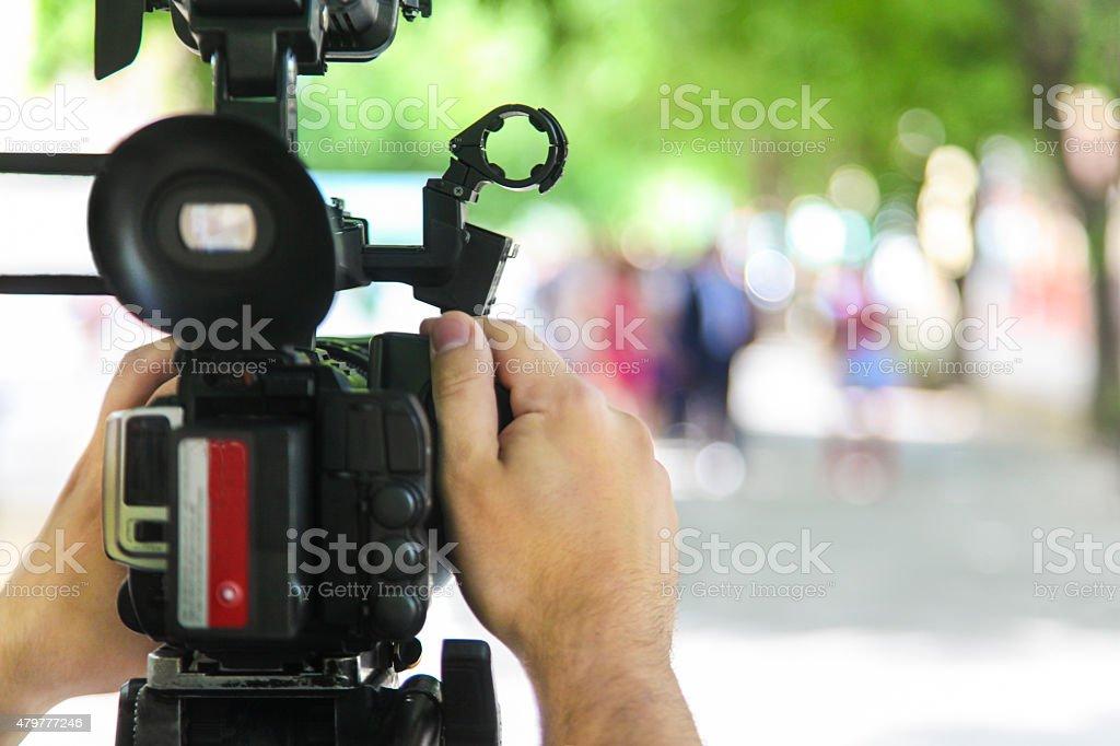 Cameraman filming outdoors stock photo