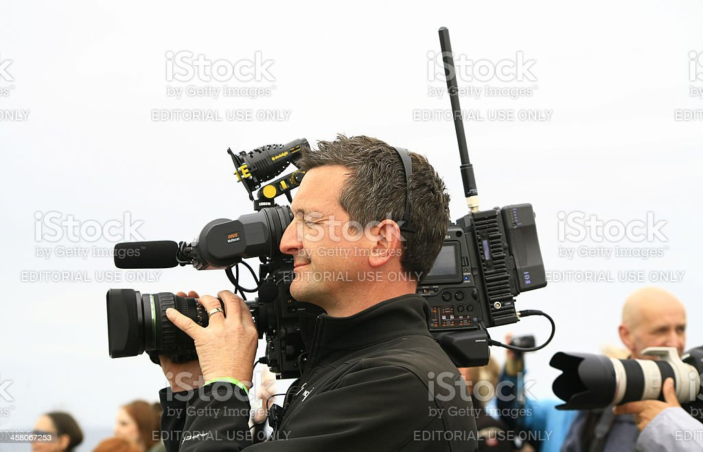 Cameraman films London 2012 Olympic Torch relay event in Scotland stock photo