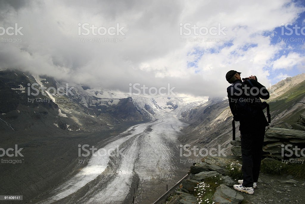 Cameraman in action on high mountain royalty-free stock photo