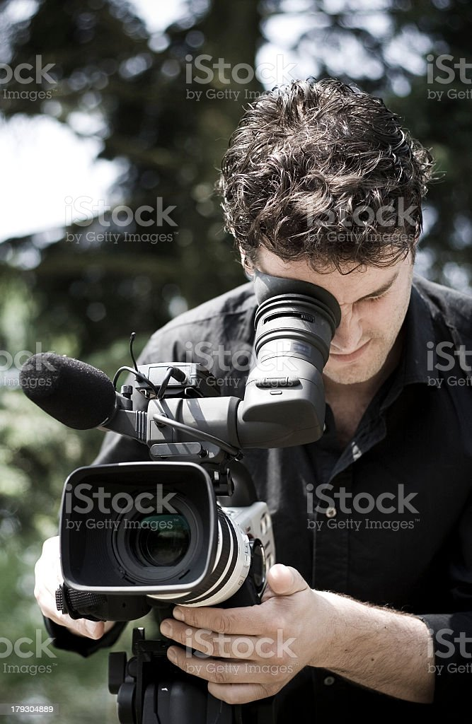Cameraman in action stock photo