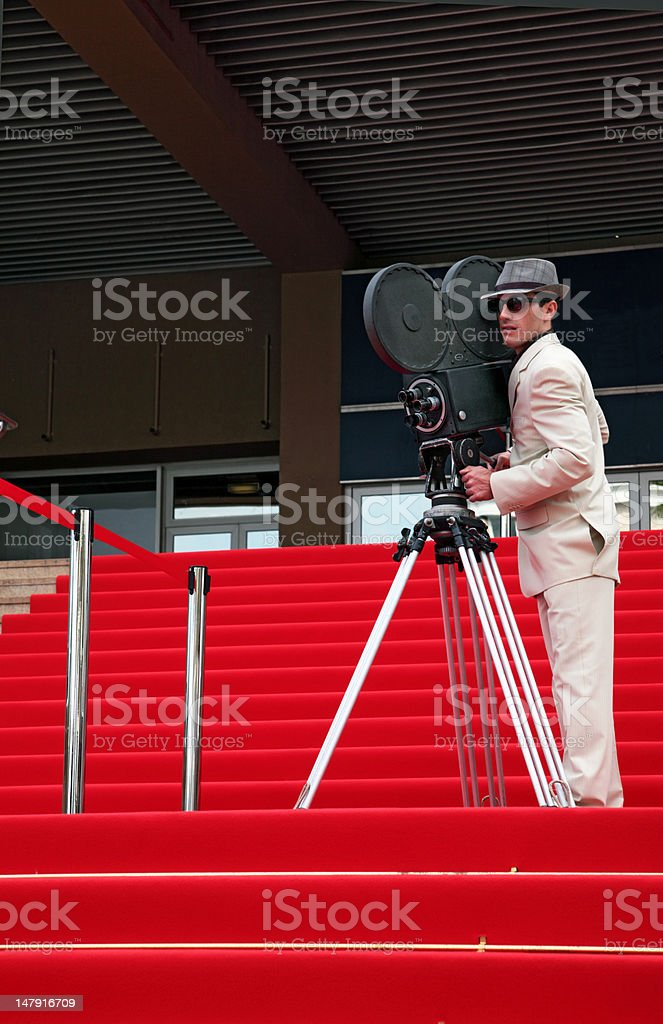 Cameraman on Red Steps stock photo