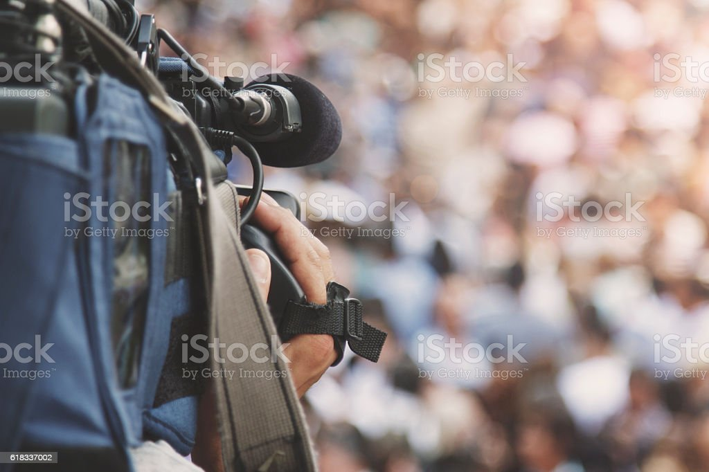 Cameraman shooting crowd stock photo