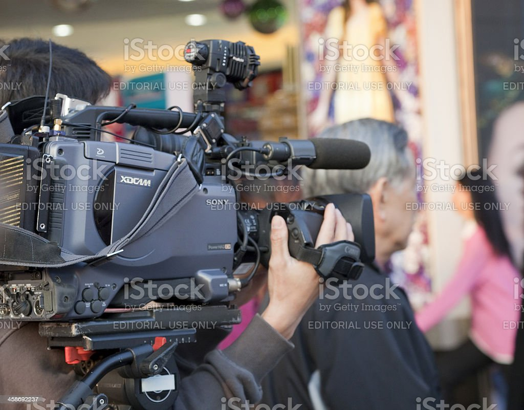 Cameraman shooting Reality TV in Hong Kong stock photo