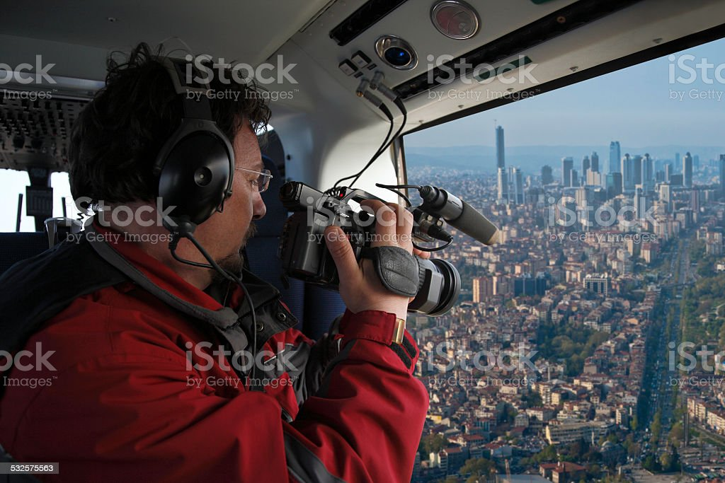 Cameraman shooting video  when flying stock photo