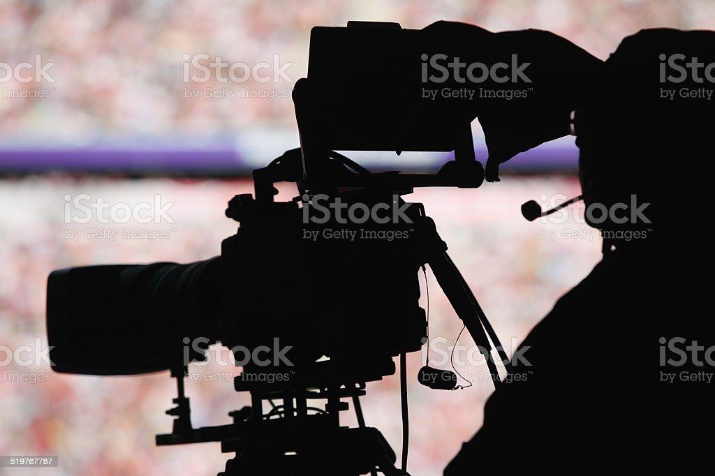 cameraman stadium stock photo