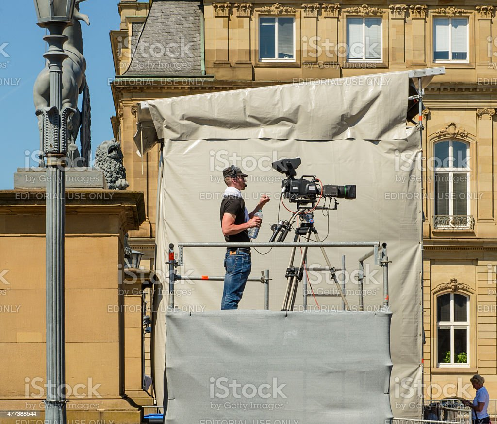 cameraman tv-camera movie-camera outdoor standing filming stock photo