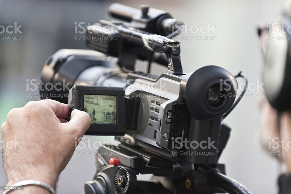 Cameraman videotaping an event royalty-free stock photo