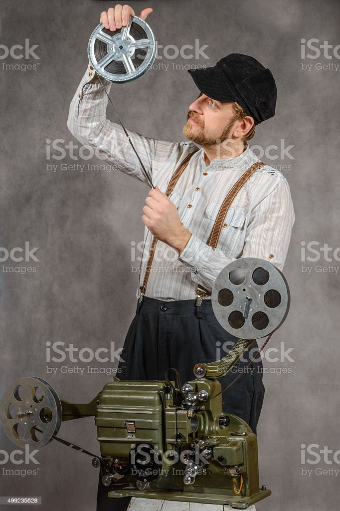 Cameraman with  a film projection stock photo