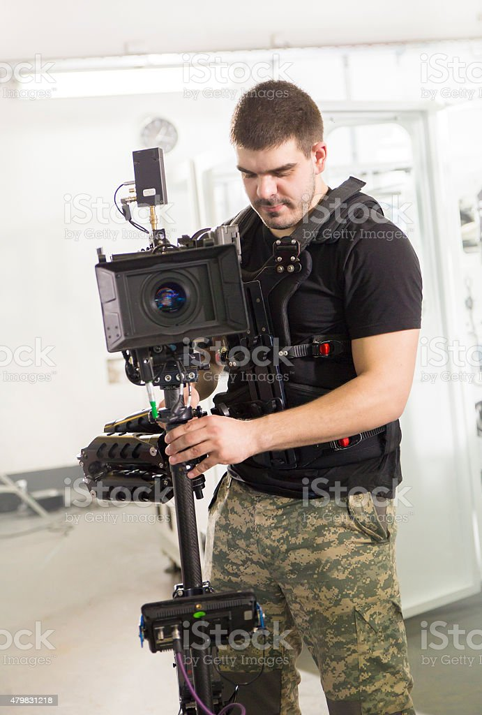 Cameraman with a steadicam and film camera stock photo