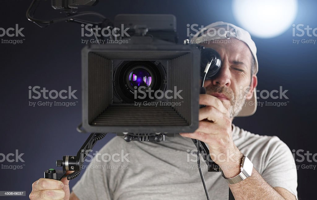cameraman working with a cinema camera on shoulder royalty-free stock photo