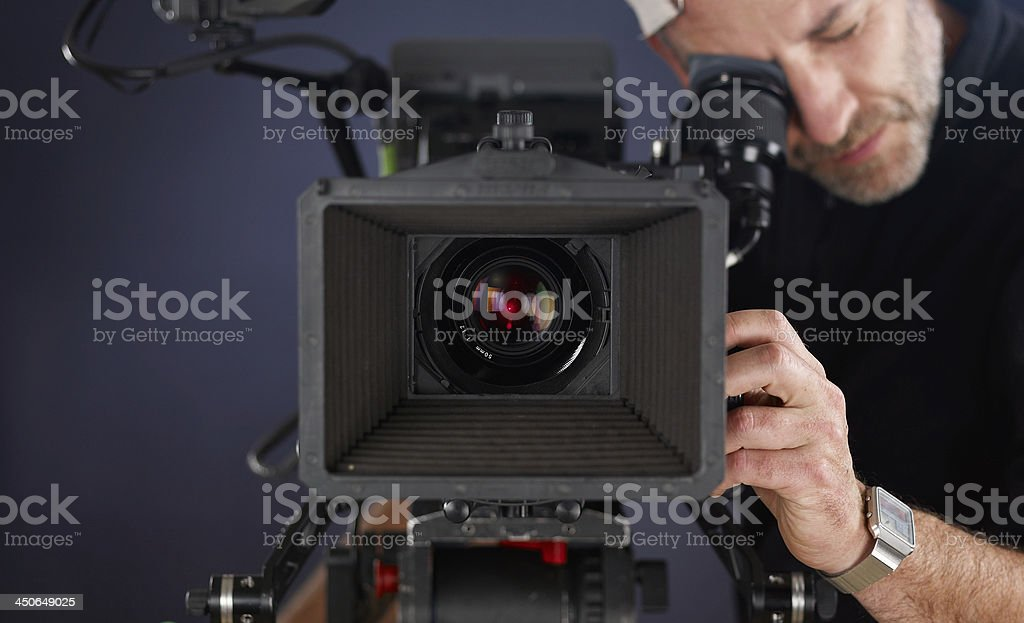 cameraman working with a cinema camera stock photo