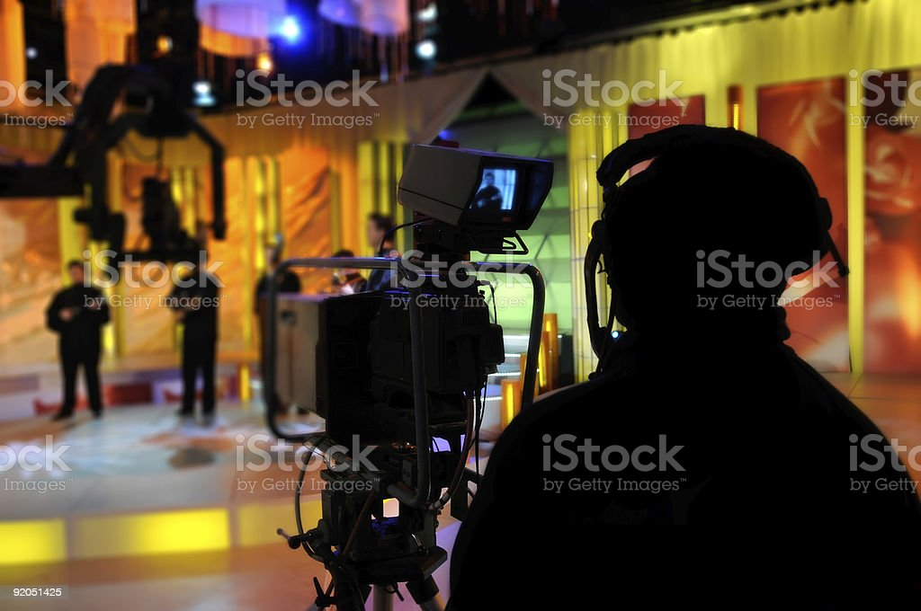 Cameraman works - recording show in TV studio stock photo