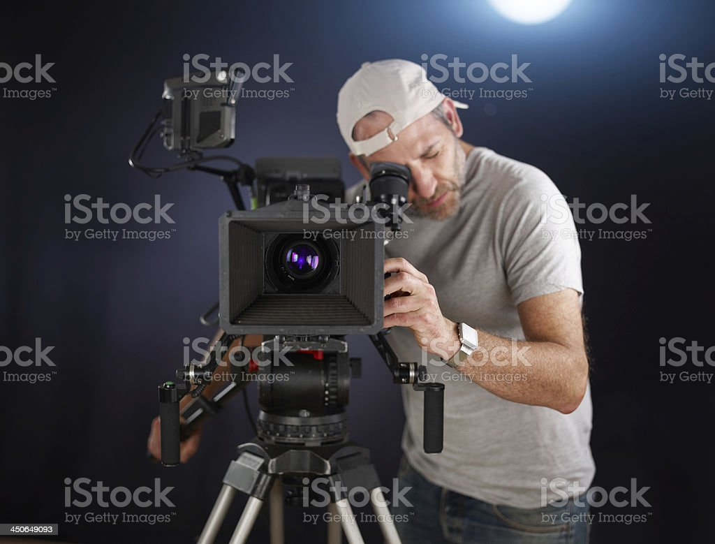 cameraoperator shoots a cinema movie stock photo