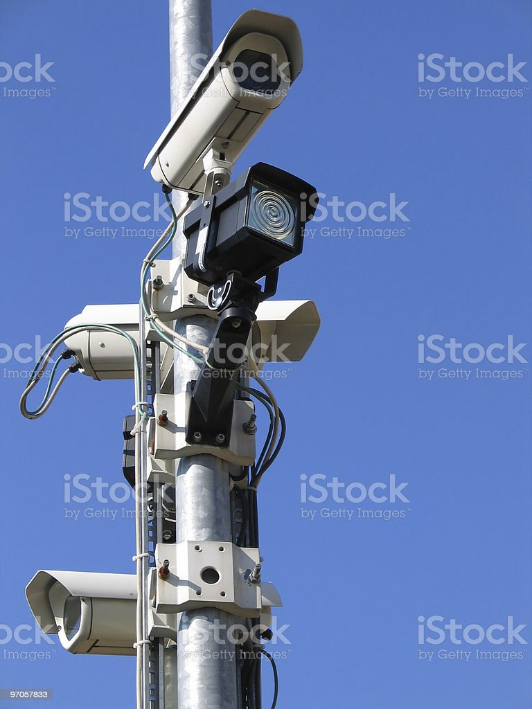 CCTV cameras in front of a clear blue sky royalty-free stock photo
