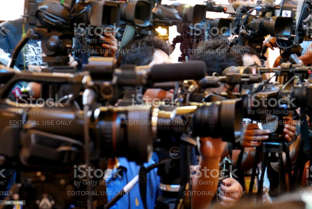 Cameras lined up covering public event stock photo