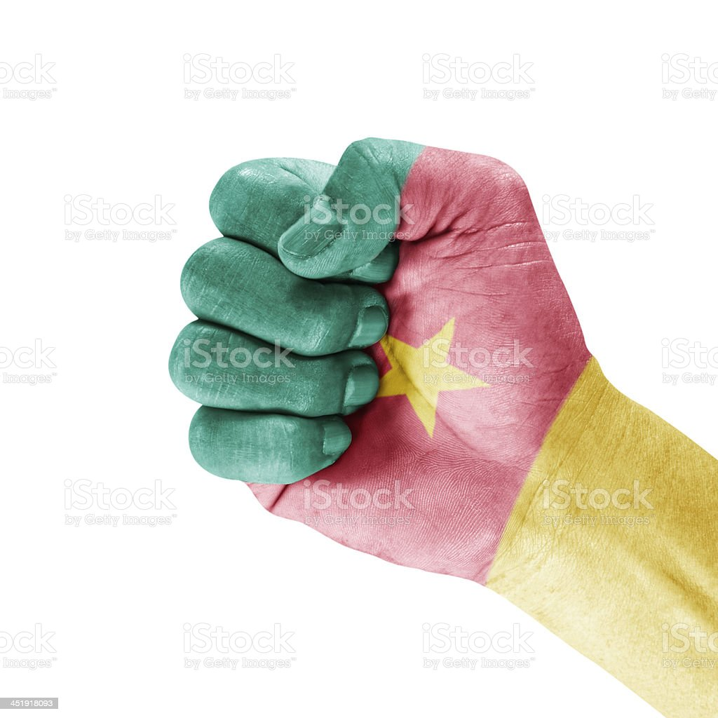 Cameroon Flag On Clenched Fist Hand royalty-free stock photo