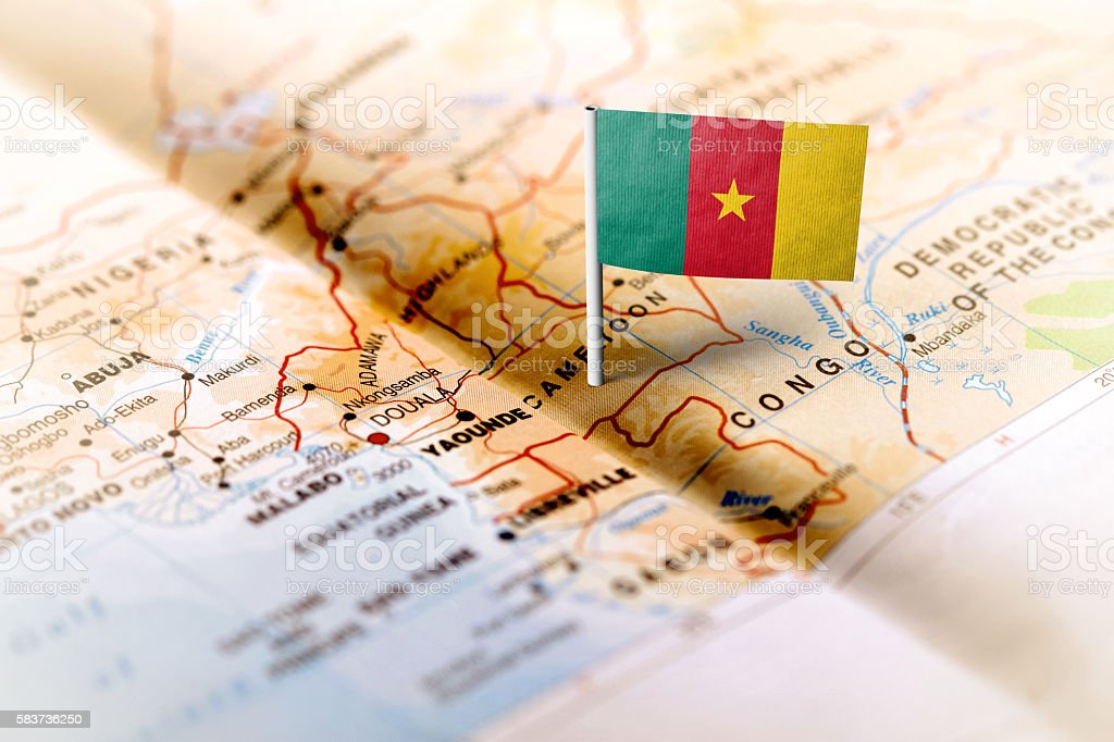 Cameroon pinned on the map with flag stock photo