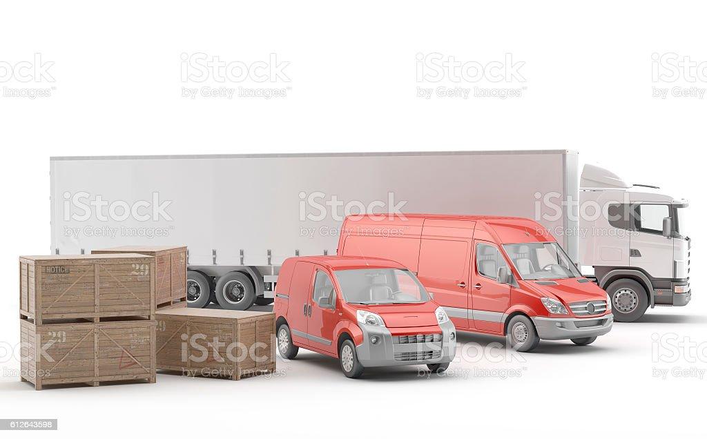 Camión blanco junto a dos furgonetas rojas y cajones stock photo
