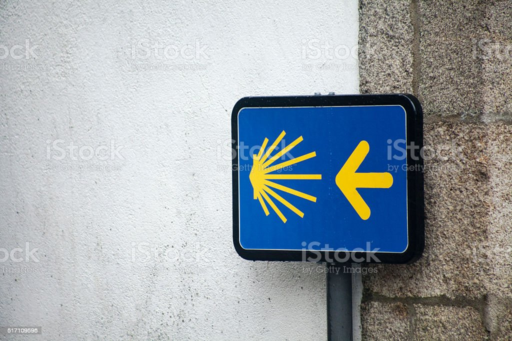 Camino de Santiago information sign and pilgrims shell stock photo