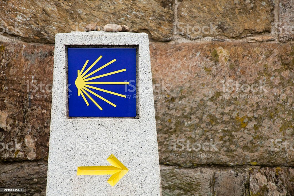 Camino de Santiago, pilgrims scallop symbol, yellow arrow. stock photo