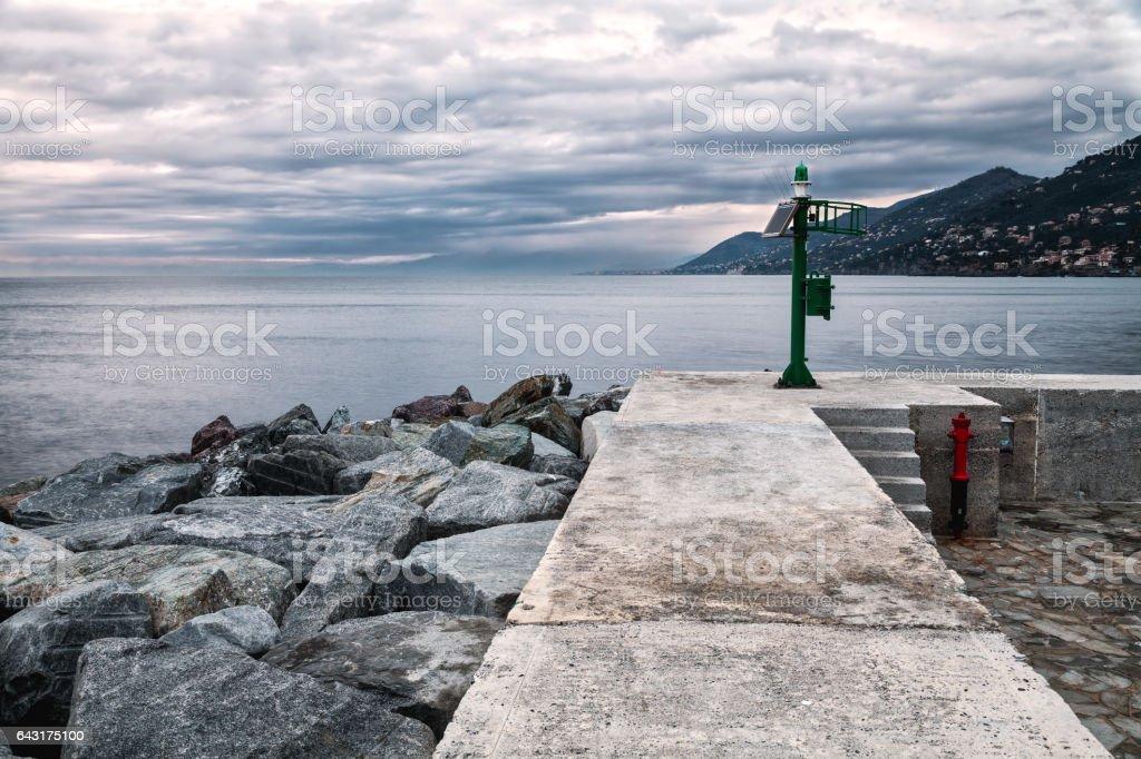 Camogli breakwater, wintertime. Color image stock photo