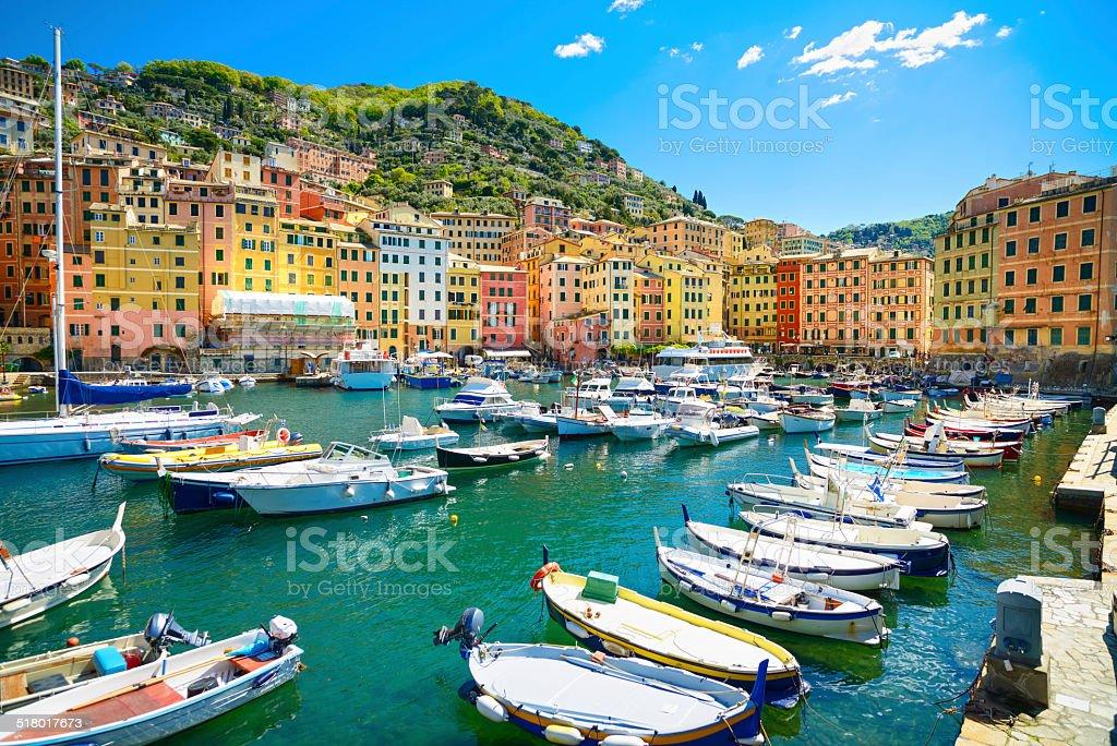 Camogli marina harbor, boats and typical colorful houses. Ligury stock photo