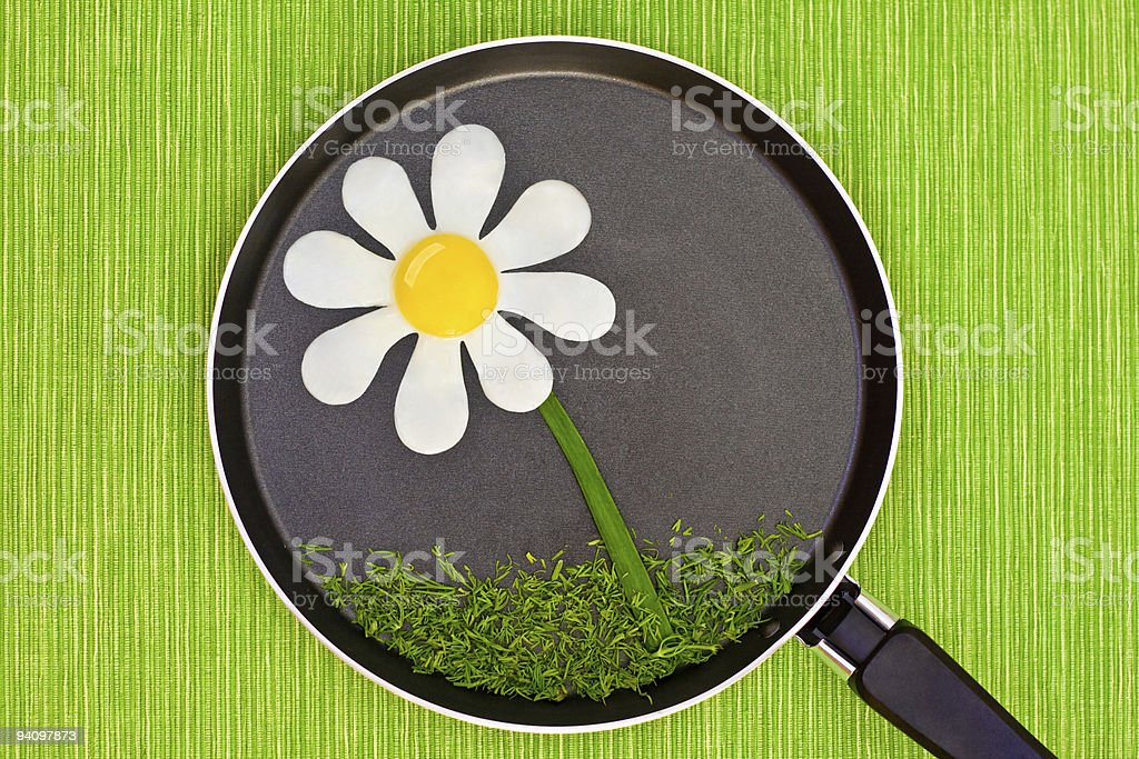 camomile from fried eggs royalty-free stock photo