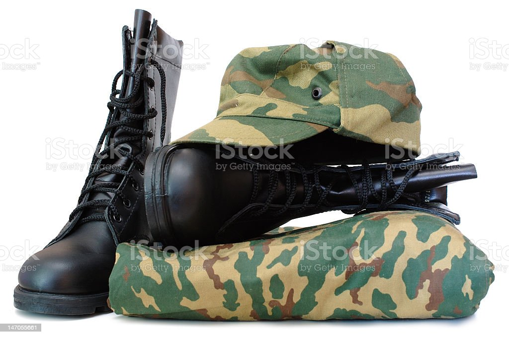 Camouflage army uniform with hat and boots stock photo