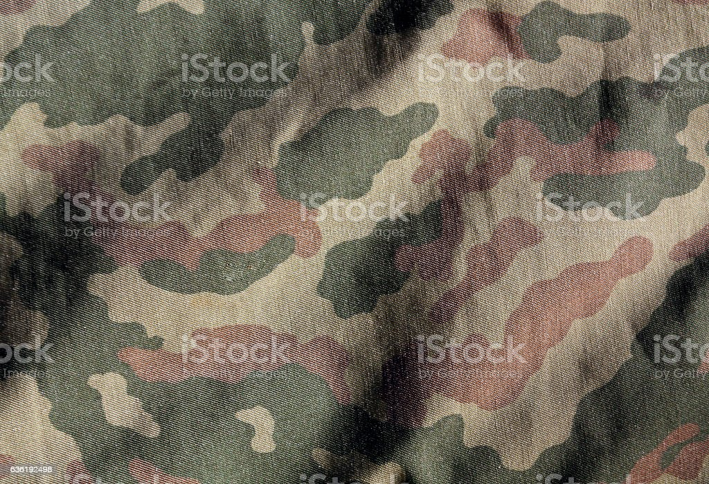 Camouflage color cloth surface. stock photo