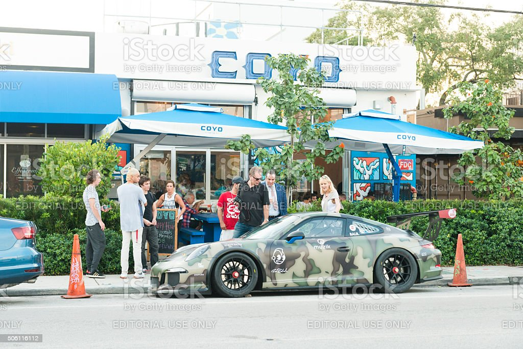 Camouflage Painted Porsche Gets Attention Parked in Wynwood Miami stock photo