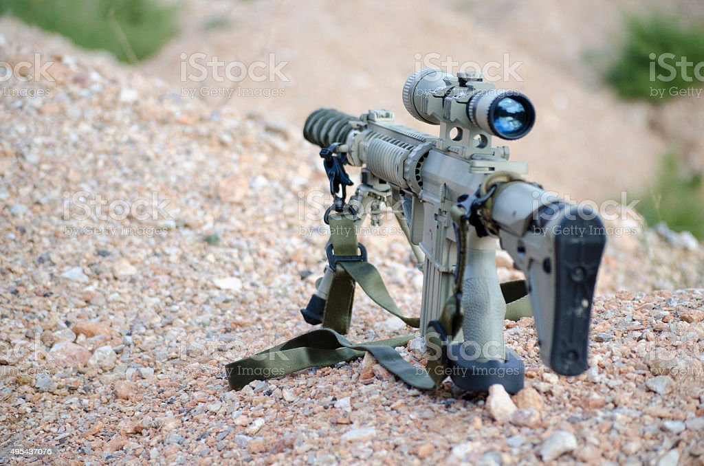 M 4 camouflage strap shoulder on ground stock photo