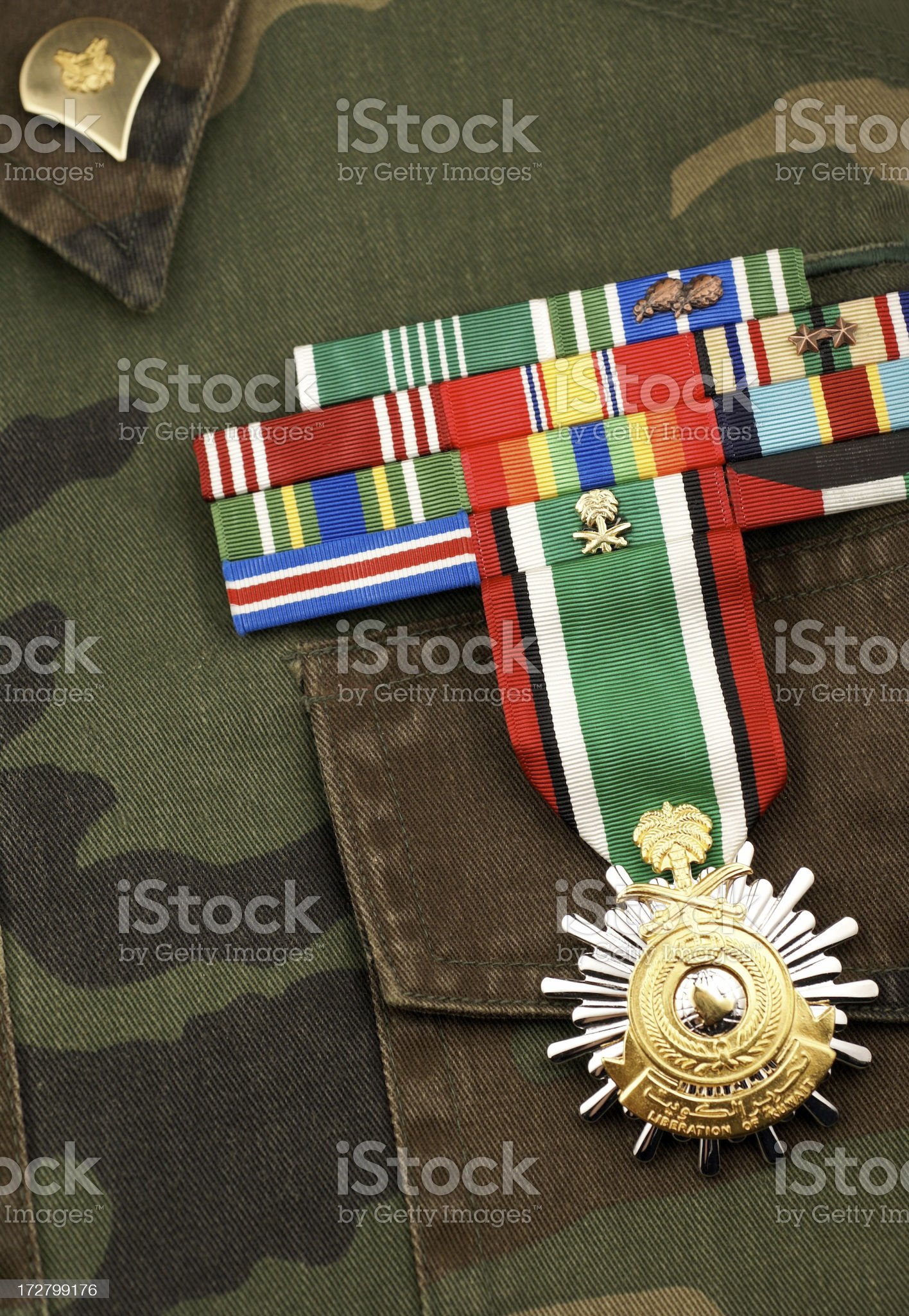 Camouflage Uniform with Ribbons and Medal royalty-free stock photo