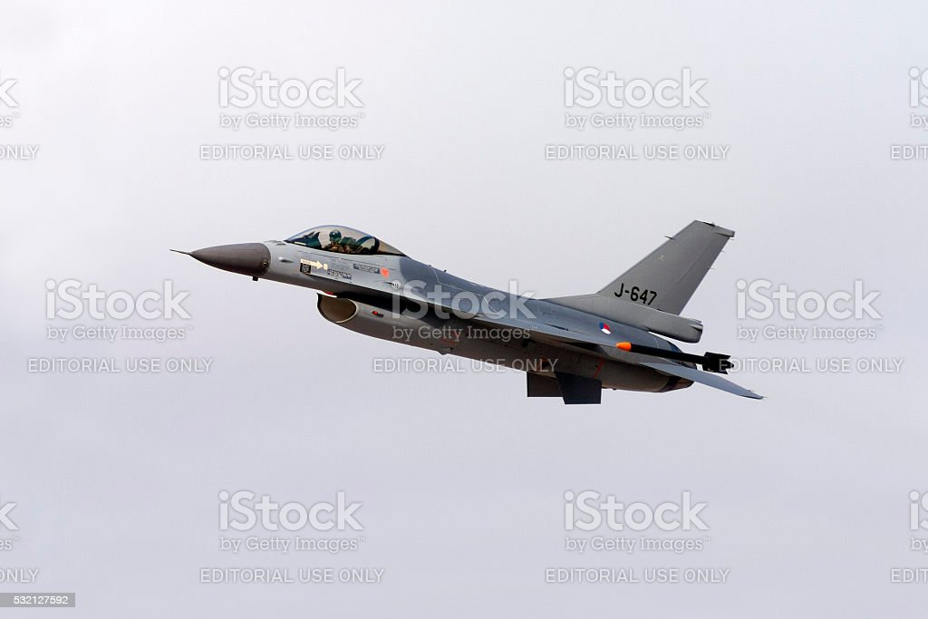 Camouflaged Dutch F-16 on take off stock photo