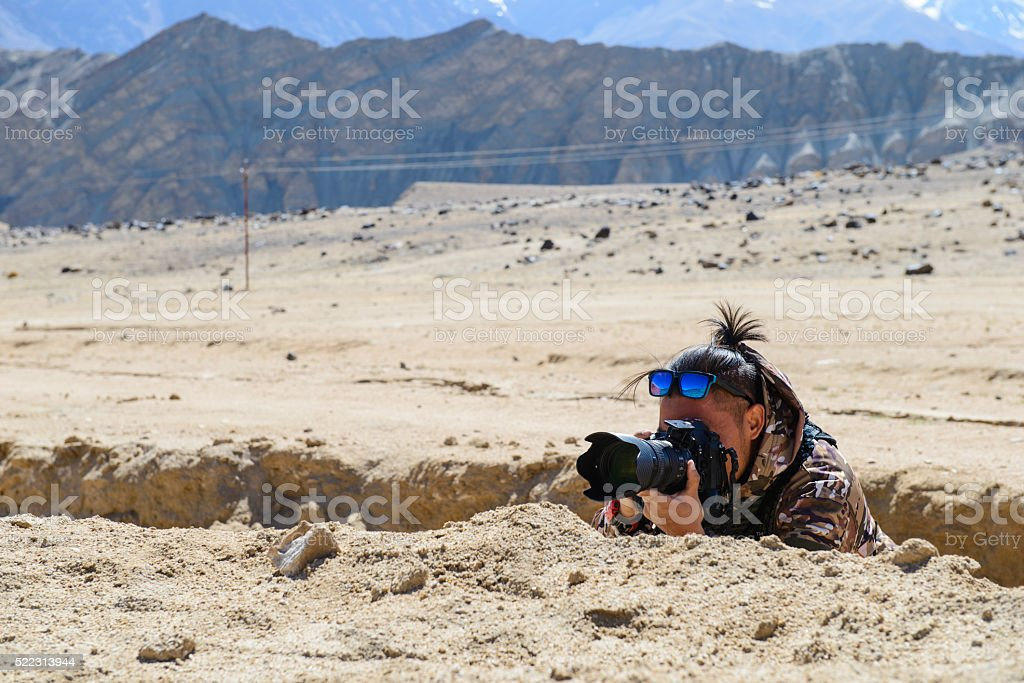 Camouflaged photographer stock photo