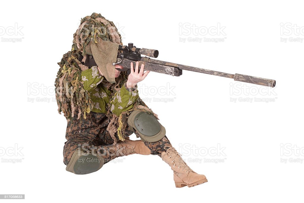 Camouflaged sniper in ghillie suit stock photo