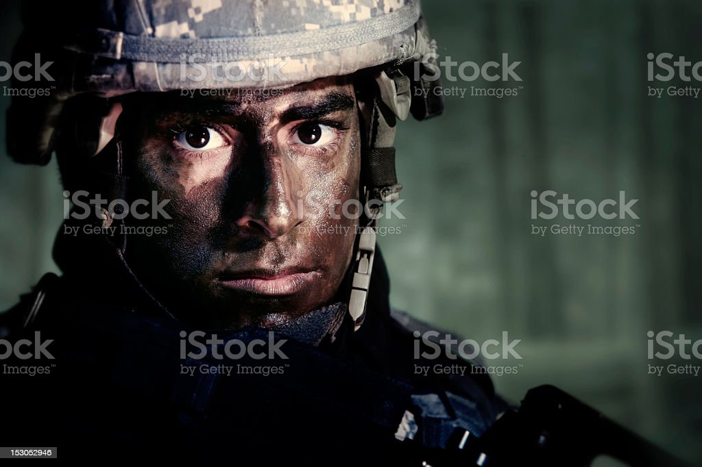Camouflaged Soldier stock photo