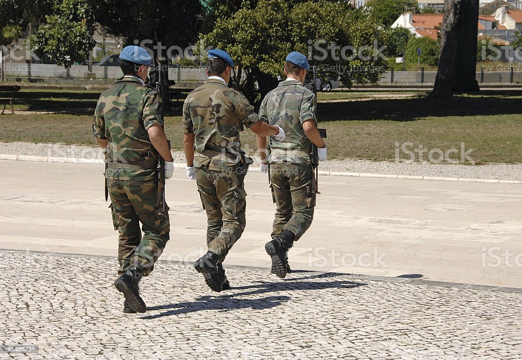 Camouflaged soldiers marching fast royalty-free stock photo