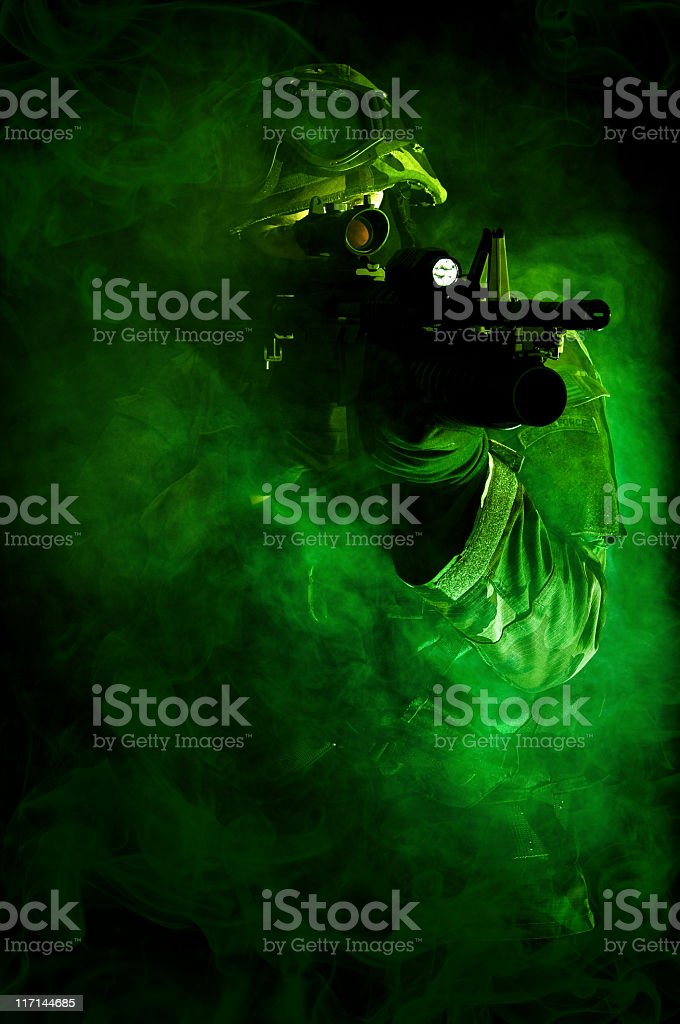 A camouflaged special forces soldier stock photo