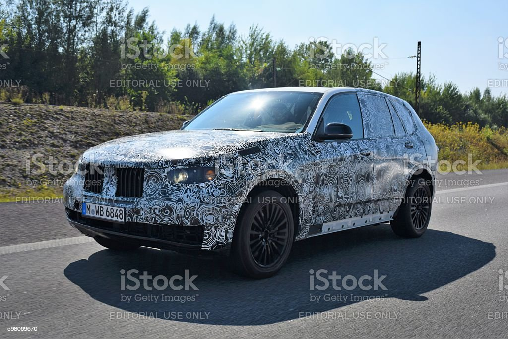 Camouflaged SUV on the highway stock photo