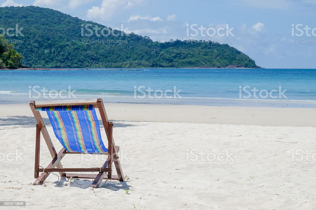camp bed on the beach stock photo