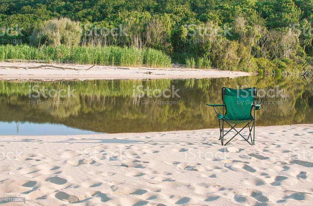 camp chair by the lake stock photo