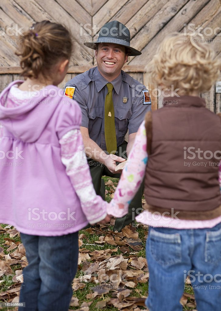 Camp counselor with children stock photo